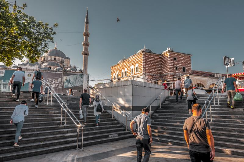 Eminonu, Istanbul. Istanbul, Turkey - June 27, 2019: Yeni Cami or The New Mosque in Eminonu, Istanbul`s most touistic and crowded area with historical landmarks stock image