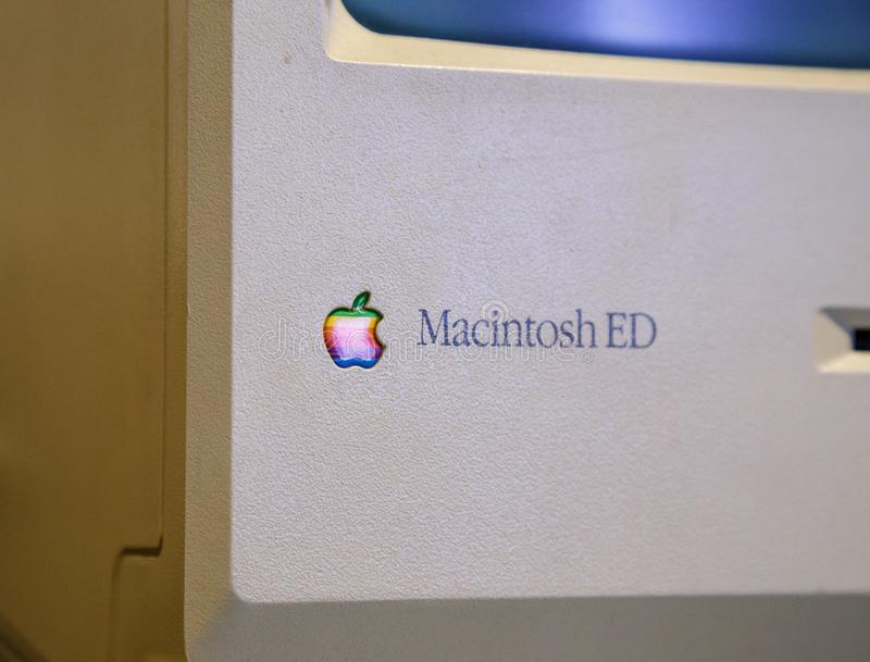 Istanbul, Turkey, March 2019: Closeup old rainbow Apple logo on old Macintosh computer. Rahmi Koc museum.  royalty free stock photos