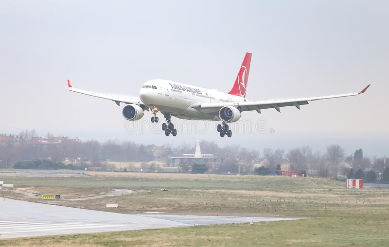 Airplane Landing to Airport. ISTANBUL, TURKEY - MARCH 04, 2018: Turkish Airlines Airbus A330-203 (CN 754) landing to Istanbul Ataturk Airport. THY is the flag stock image