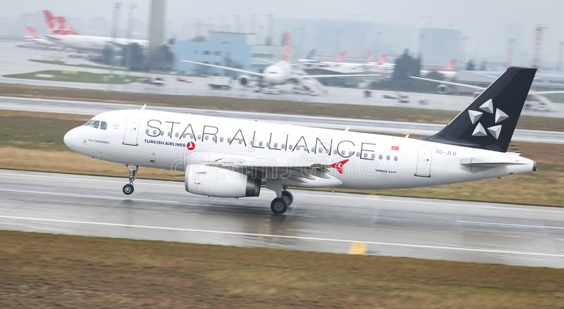 Airplane Landing to Airport. ISTANBUL, TURKEY - MARCH 04, 2018: Turkish Airlines Airbus A319-132 (CN 4695) landing to Istanbul Ataturk Airport. THY is the flag stock images