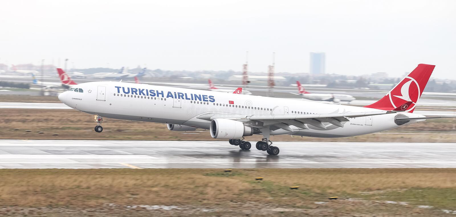 Airplane Landing to Airport. ISTANBUL, TURKEY - MARCH 04, 2018: Turkish Airlines Airbus A330-303 (CN 1644) landing to Istanbul Ataturk Airport. THY is the flag royalty free stock photo