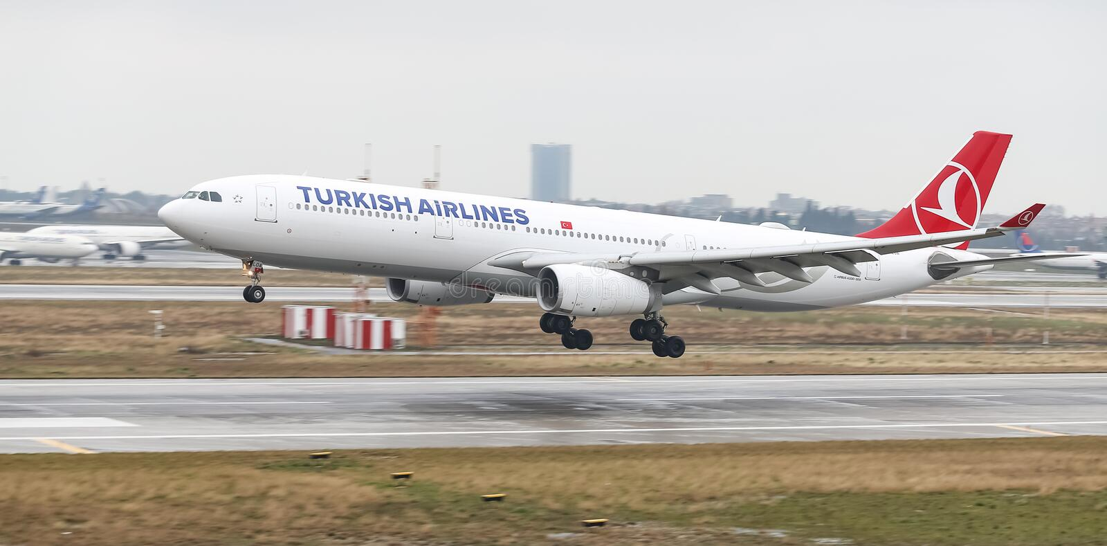 Airplane Landing to Airport. ISTANBUL, TURKEY - MARCH 04, 2018: Turkish Airlines Airbus A330-343E (CN 1483) landing to Istanbul Ataturk Airport. THY is the flag royalty free stock photography