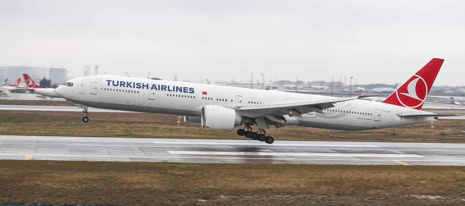 Airplane Landing to Airport. ISTANBUL, TURKEY - MARCH 04, 2018: Turkish Airlines Boeing 777-3F2ER (CN 44116) landing to Istanbul Ataturk Airport. THY is the flag stock photography