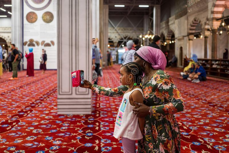 Istanbul, Turkey - May 20, 2018: Mother and daughter make a selfie in the Blue Mosque Sultan Ahmed. stock images