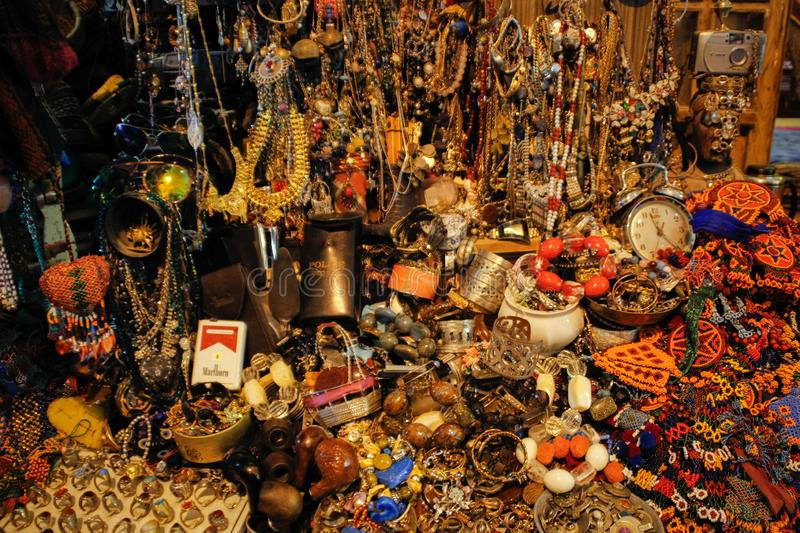 Randomly scattered bracelets, beads, earrings and rings made of precious metals and stones on the Istanbul market stock photos