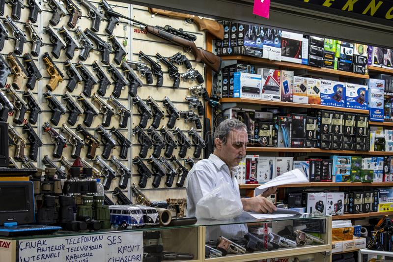 Istanbul, Turkey, Middle East, daily life, weapon, arms, salesman, shop, rifle, gun, streets. Istanbul, Turkey, Middle East: daily life in the city, an arms stock image