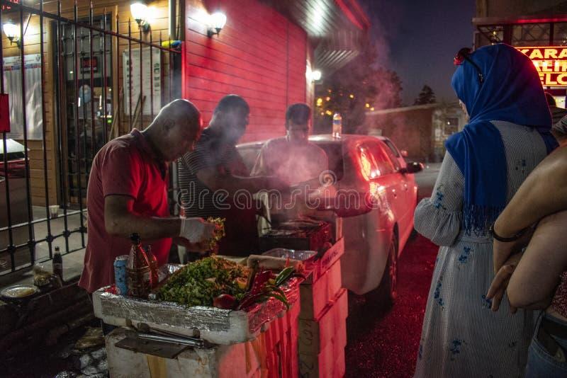 Istanbul, Turkey, Middle East, nightlife, street food, fish, vendor, kiosk, men, market, night out, barbecue, fish market. Istanbul, Turkey, Middle East stock photo