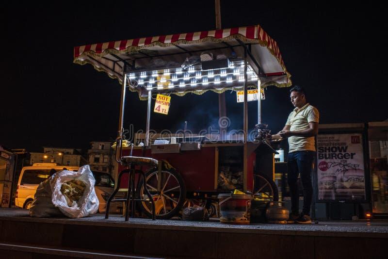Istanbul, Turkey, Middle East, nightlife, street food, corn vendor, kiosk, man, market, night out, barbecue. Istanbul, Turkey, Middle East: nightlife in the city stock images