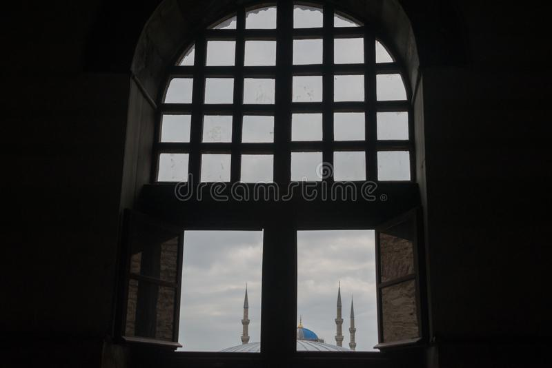 Istanbul, Turkey: Minarets of the Blue mosque. View from the window of Hagia Sophia-the interior of the Basilica stock images