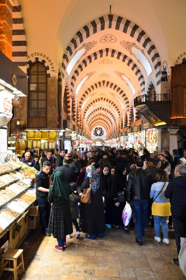 Istanbul Turkey misir carsisi and people, carsi bazar. In the Misir Carsisi built in the 17th century, locals and tourists from various countries of the world stock photo