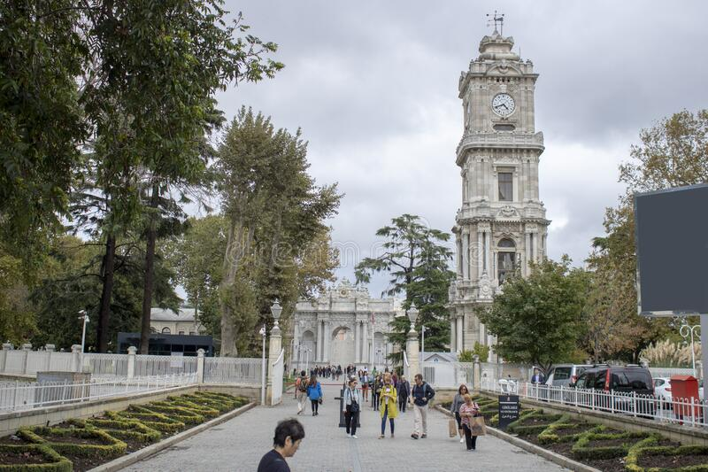 Photo of Dolmabahce Palace with entrance and clock tower. The palace where Turkish leader Ataturk died. royalty free stock images