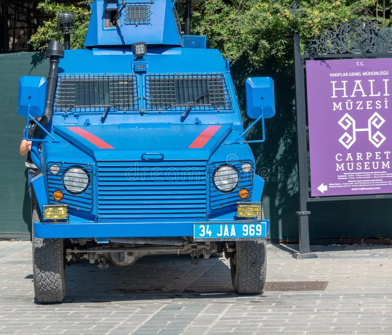 Istanbul, Turkey, September 2018: Bright blue painted armoured car of the Turkish police in front of the entrance of the Teppich stock photos