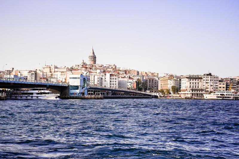 Istanbul / Turkey - September 25, 2014: Cityscape of Galata modern Karakoy with the Galata bridge and restaurants in Istanbul. Ima stock images