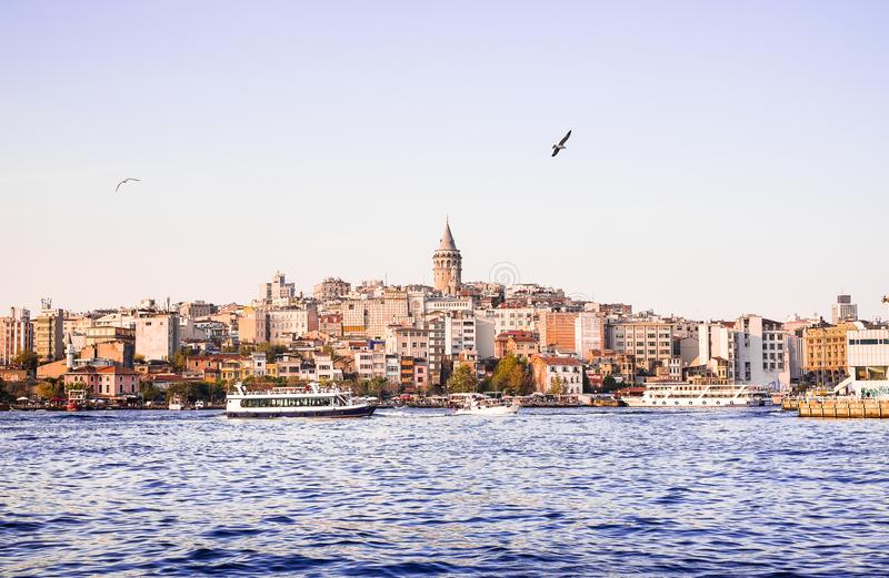 Istanbul / Turkey - September 25, 2014: Cityscape of Galata modern Karakoy with the Galata bridge and restaurants in Istanbul. Ima royalty free stock images