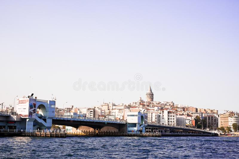 Istanbul / Turkey - September 25, 2014: Cityscape of Galata modern Karakoy with the Galata Tower and Galata bridge over the Gold stock photography