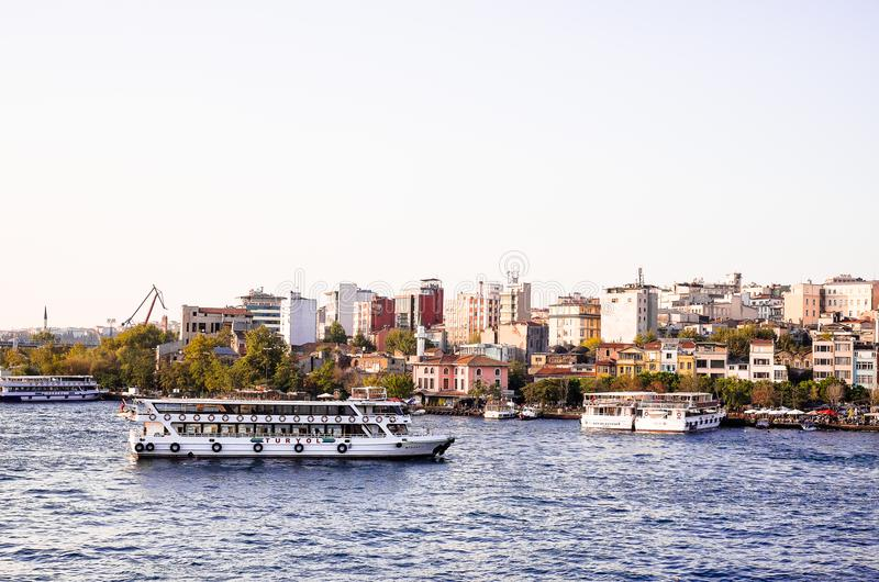 Istanbul / Turkey - September 26, 2014: Landmark of the houses and fish market at Karakoy ferryboat dock or pier at Golden Horn in royalty free stock images