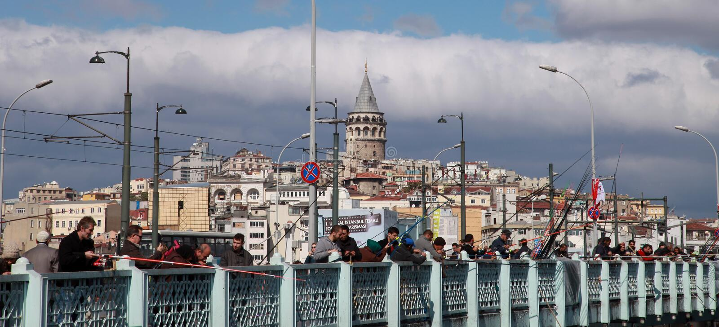 People fishing on the Galata Bridge. ISTANBUL, TURKEY - SEPTEMBER 25: People fishing on the Galata Bridge in Eminonu Coastline on September 25, 2013 in Istanbul royalty free stock images