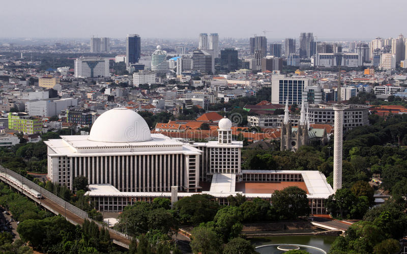 Istiqlal Mosque in Jakarta, large mulslim building, Indonesia. Istiqlal Mosque in Jakarta, large mulslim building, seen from Monas tower on a sunny day stock photography