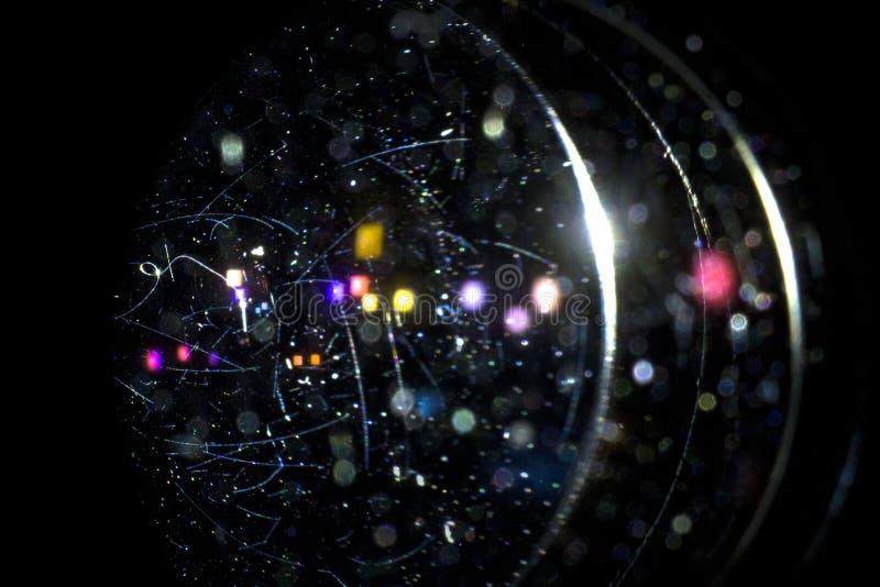 Istne pył cząsteczki, narysy na obiektywach z i, popierają światło i bokeh skutek obrazy royalty free
