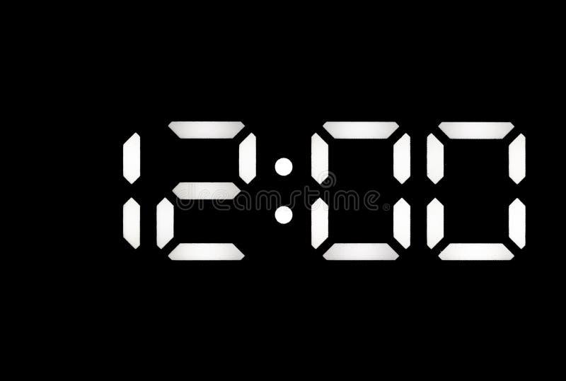 Istny biały dowodzony cyfrowy zegar na czarnym tle obrazy stock
