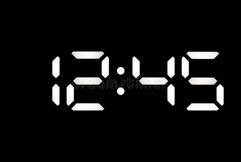 Istny biały dowodzony cyfrowy zegar na czarnym tle fotografia stock