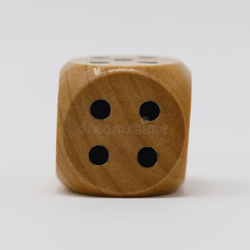 Istny Drewniany kostka do gry 4 punkt obrazy stock