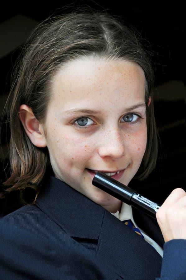 Istruisca la penna di holding della ragazza fotografie stock