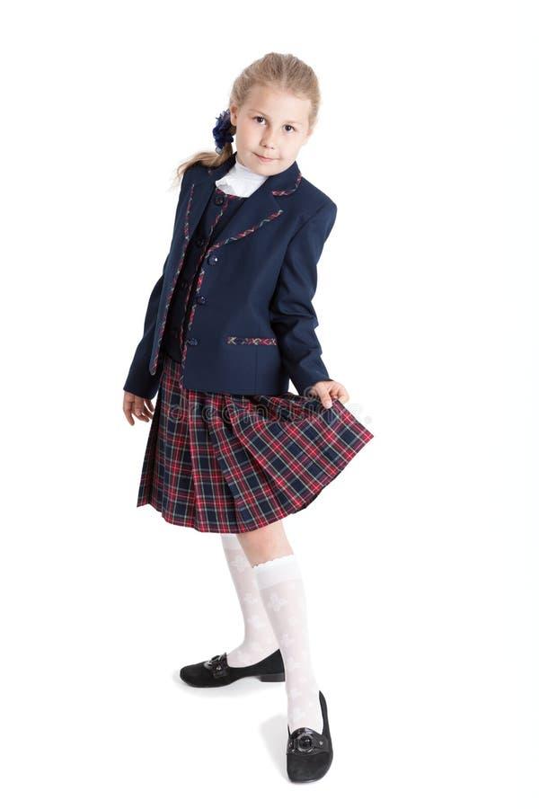 Istruisca la ragazza in ritratto integrale della giacca blu e della gonna, fondo bianco isolato immagini stock
