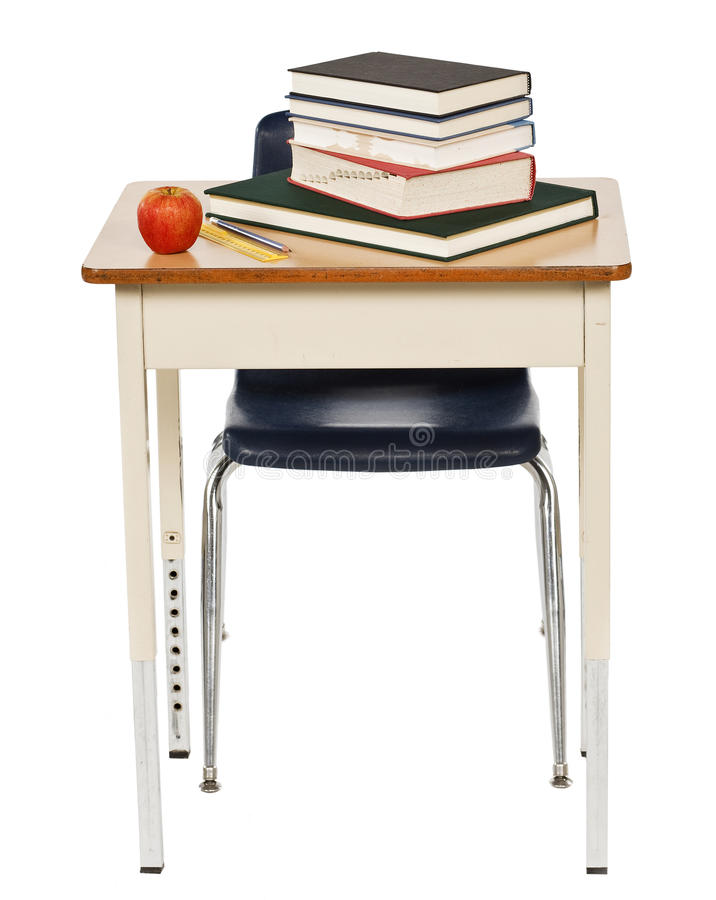 Istruisca lo scrittorio e la sedia con i libri e la mela isolata su bianco immagini stock