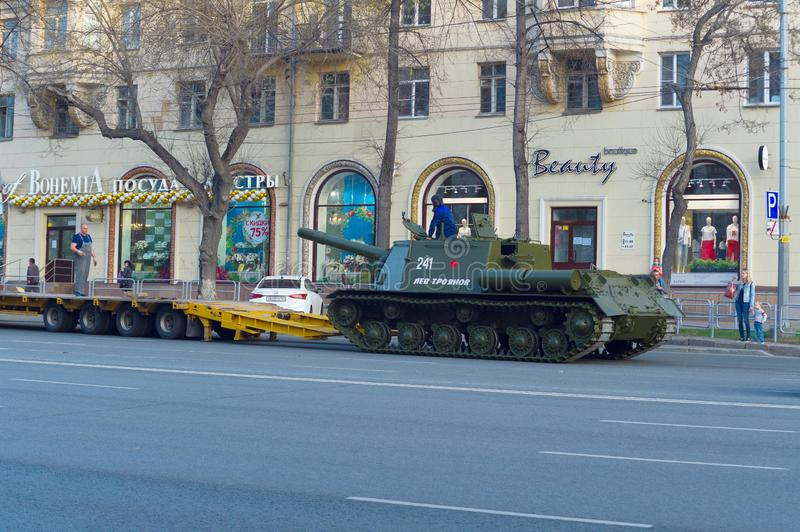 ISU-152 is on asphalt and is preparing to climb the trawl along the gangways. Chelyabinsk, Russia - May 2019: Transportation of heavy armored vehicles along royalty free stock image