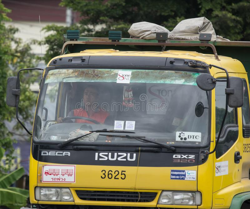 Isuzu Trailer dump truck of D stone company. Chiangmai, Thailand - July 24 2018: Driver of Isuzu Trailer dump truck of D stone company. On road no.1001, 8 km royalty free stock images