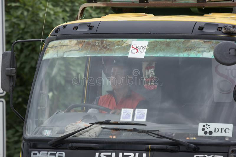 Isuzu Trailer dump truck of D stone company. Chiangmai, Thailand - July 24 2018: Driver of Isuzu Trailer dump truck of D stone company. On road no.1001, 8 km stock images