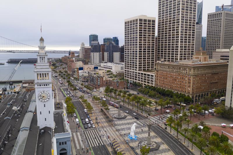 Aerial View Over Ferry Marketplace Downtown City Center Waterfront. It's an overcast morning on the wharfs and waterfront of San Francisco California stock images