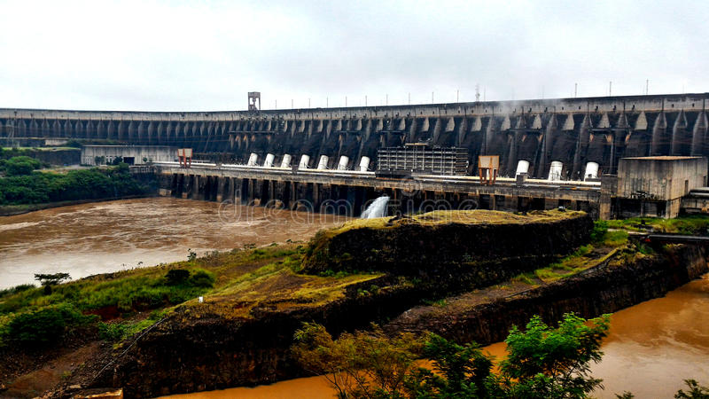 Itaipu Dam - Foz do Iguaçu / Brazil. The Itaipu Dam is a hydroelectric dam on the Paraná River located on the border between Brazil and Paraguay. The name stock photography