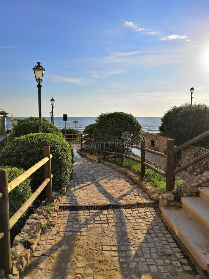 Italië, overzees, zon, wolken, hemel, omheining, lichten stock afbeeldingen
