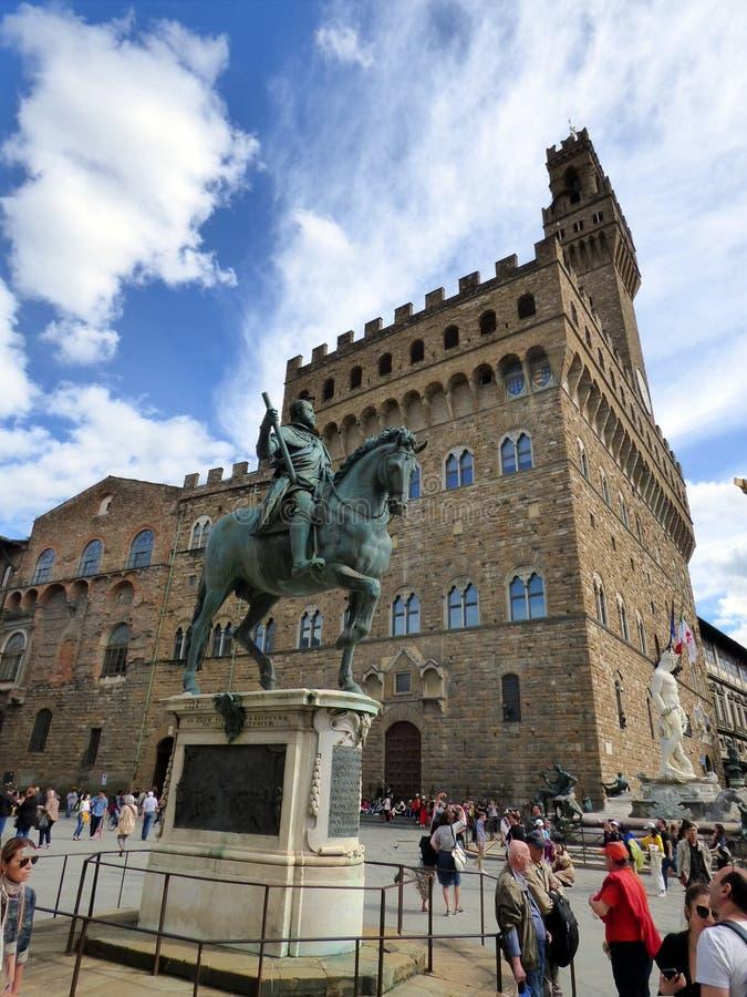 Italia. Firenze. Piazza della Signoria. Equestrian statue of the Duke of Florence Cosimo I de Medici and the palazzo vecchio. Piazza della Signoria royalty free stock image