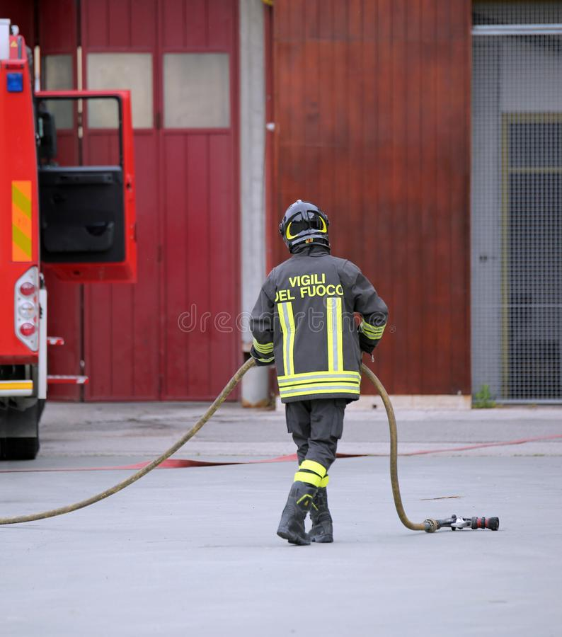 Italia, IT, Italy - May 10, 2018: Italian firefighter with unifiorm and text Vigili del fuoco that means Firemen in Italian royalty free stock photo