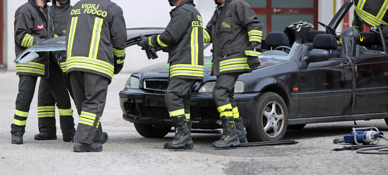Italia, IT, Italy - May 10, 2018: Italian firefighters during a. Practice exercise with a broken car after the road accident royalty free stock photos
