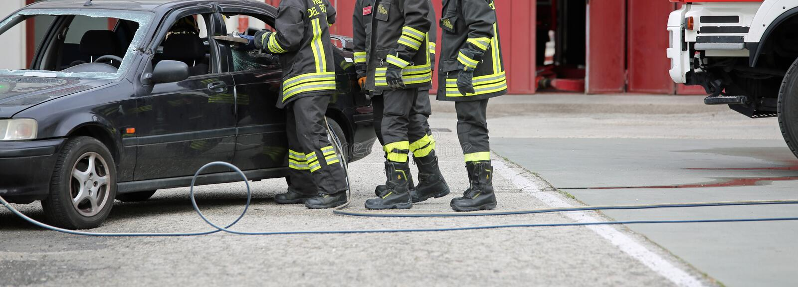 Italia, IT, Italy - May 10, 2018: Italian firefighters use the s. Hears to free the injured from the car during a practice exercise royalty free stock images