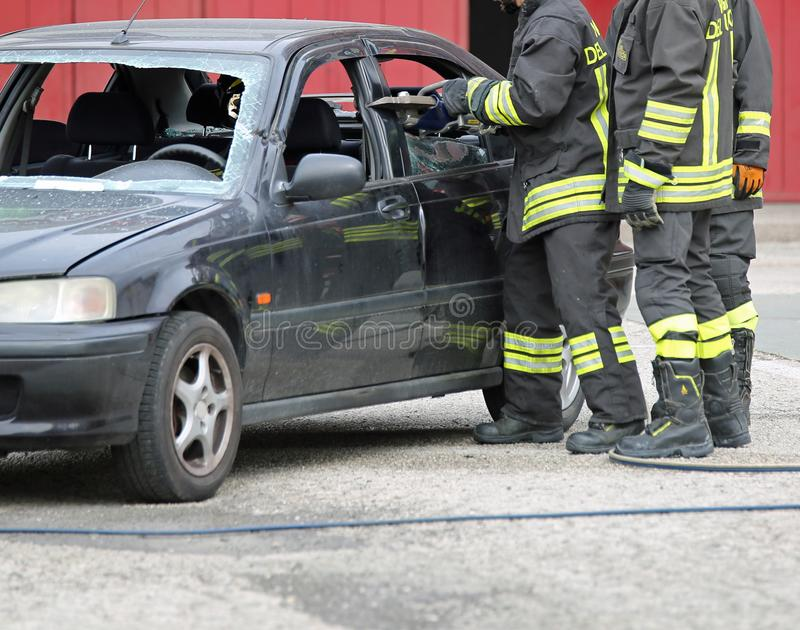 Italia, IT, Italy - May 10, 2018: Italian firefighters use the s. Italia, IT, Italy - May 10, 2018: Italian firemen use the shears to free the injured on the car royalty free stock image