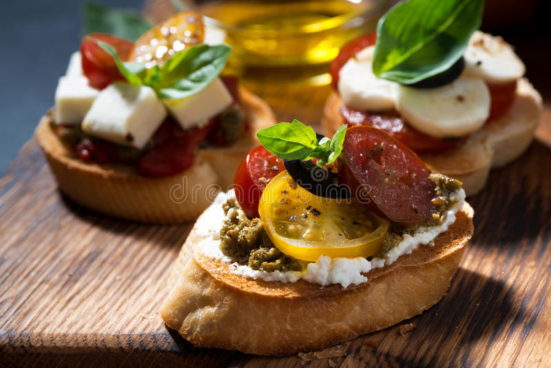 Italian antipasti on a cutting board, closeup stock image