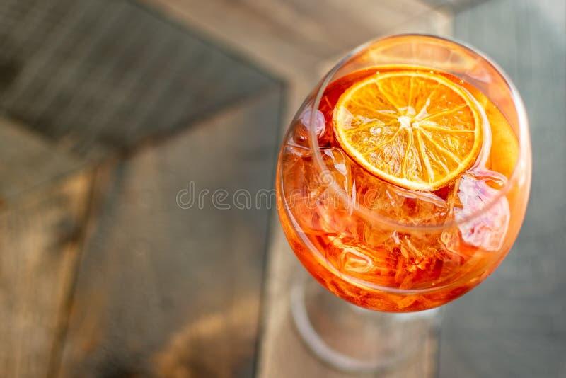 Italian aperitif `aperol stpritz` with ice and a slice of orange stock photos