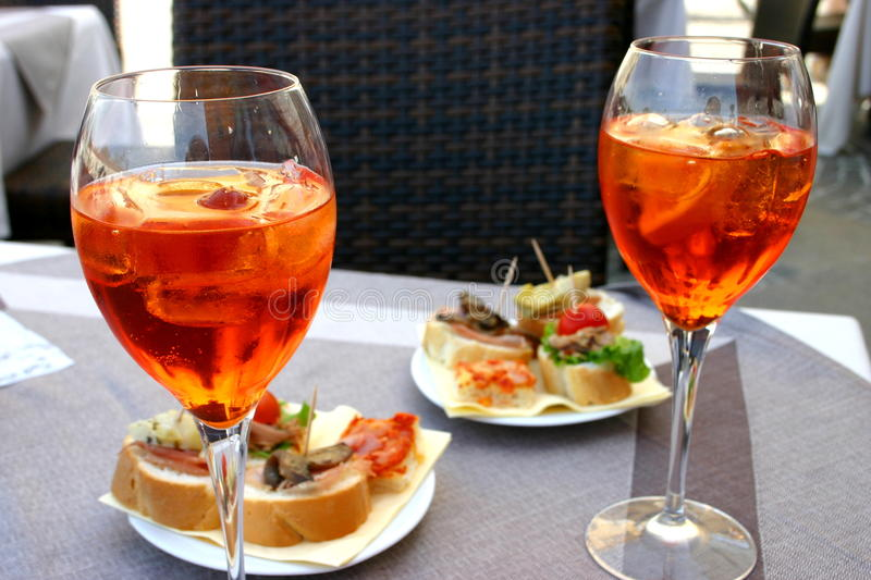 Italian Apero with Aperol Spritz. Aperol Spritz and some apetizers royalty free stock photo