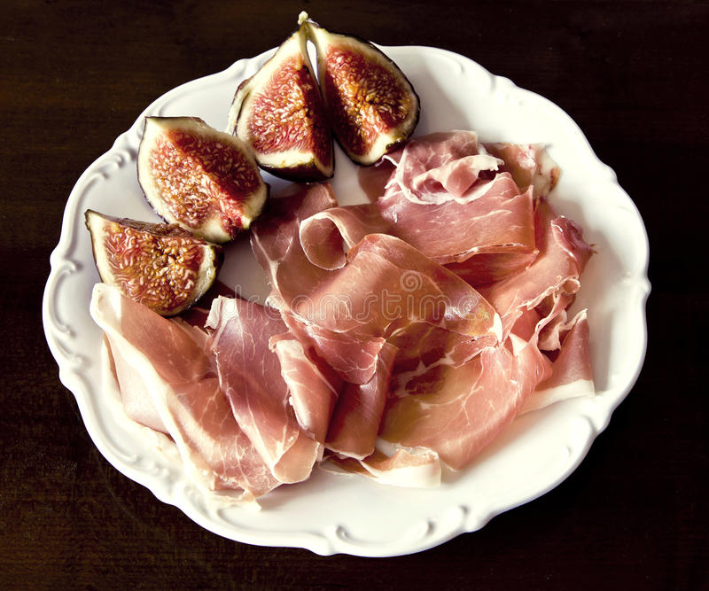 Italian appetizer, figs and raw ham