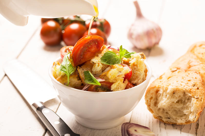 Italian Appetizer salad with tomatoes, bread and bazil. Italian Appetizer salad with tomatoes, bread,bazil mixed with lemon juice and olive oil royalty free stock photography