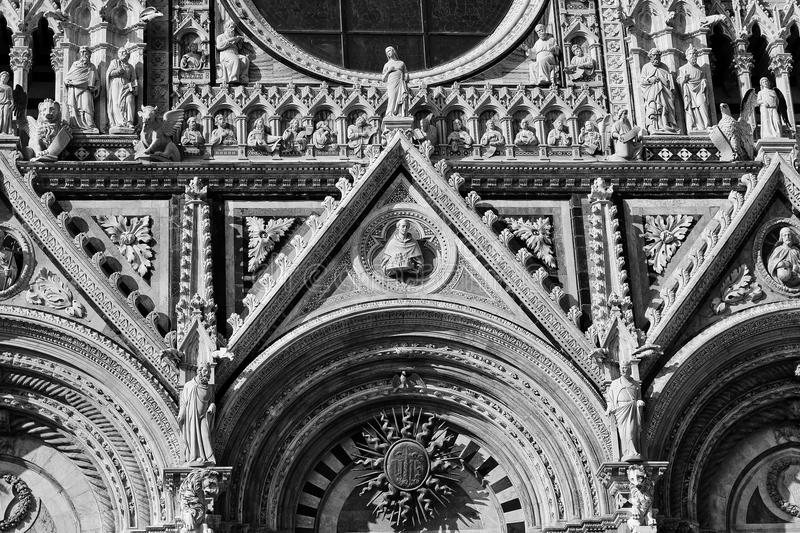 Italian architectural details of the cathedral in Siena royalty free stock images