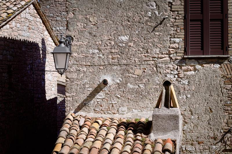Italian architectural details - Roof and chimney stock image