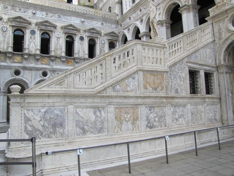 Italian architectural styles on display in Venice. Venice,Italy`s building`s have beautiful stone staircases, statues, murals, windows and other features, that royalty free stock photos