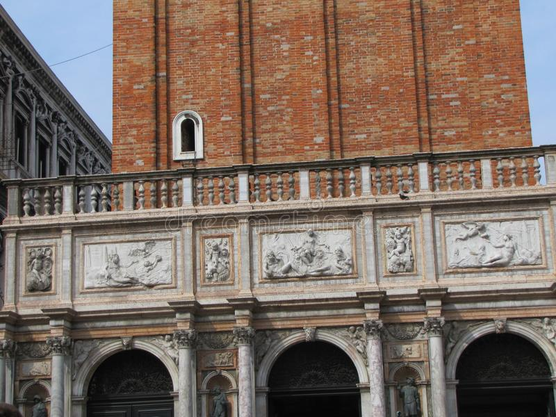 Italian architectural styles on display in Venice. Venice,Italy`s building`s have beautiful stone staircases, statues, murals, windows and other features, that stock photos