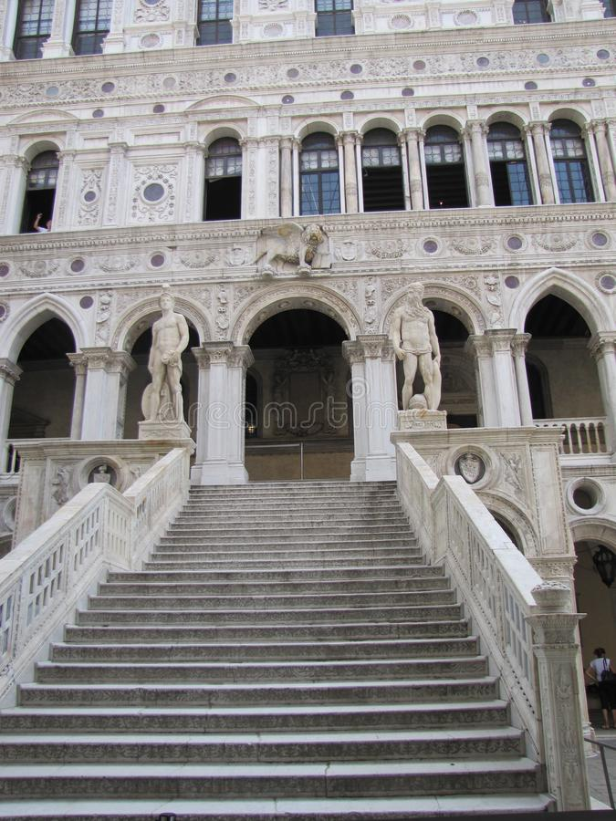 Italian architectural styles on display in Venice. Venice,Italy`s building`s have beautiful stone staircases, statues, murals, windows and other features, that stock photo
